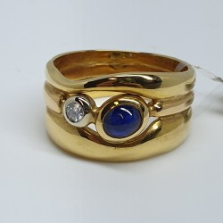 anello-fascia-oro-giallo-zaffiro-cabochon-e-diamante-taglio-brillante